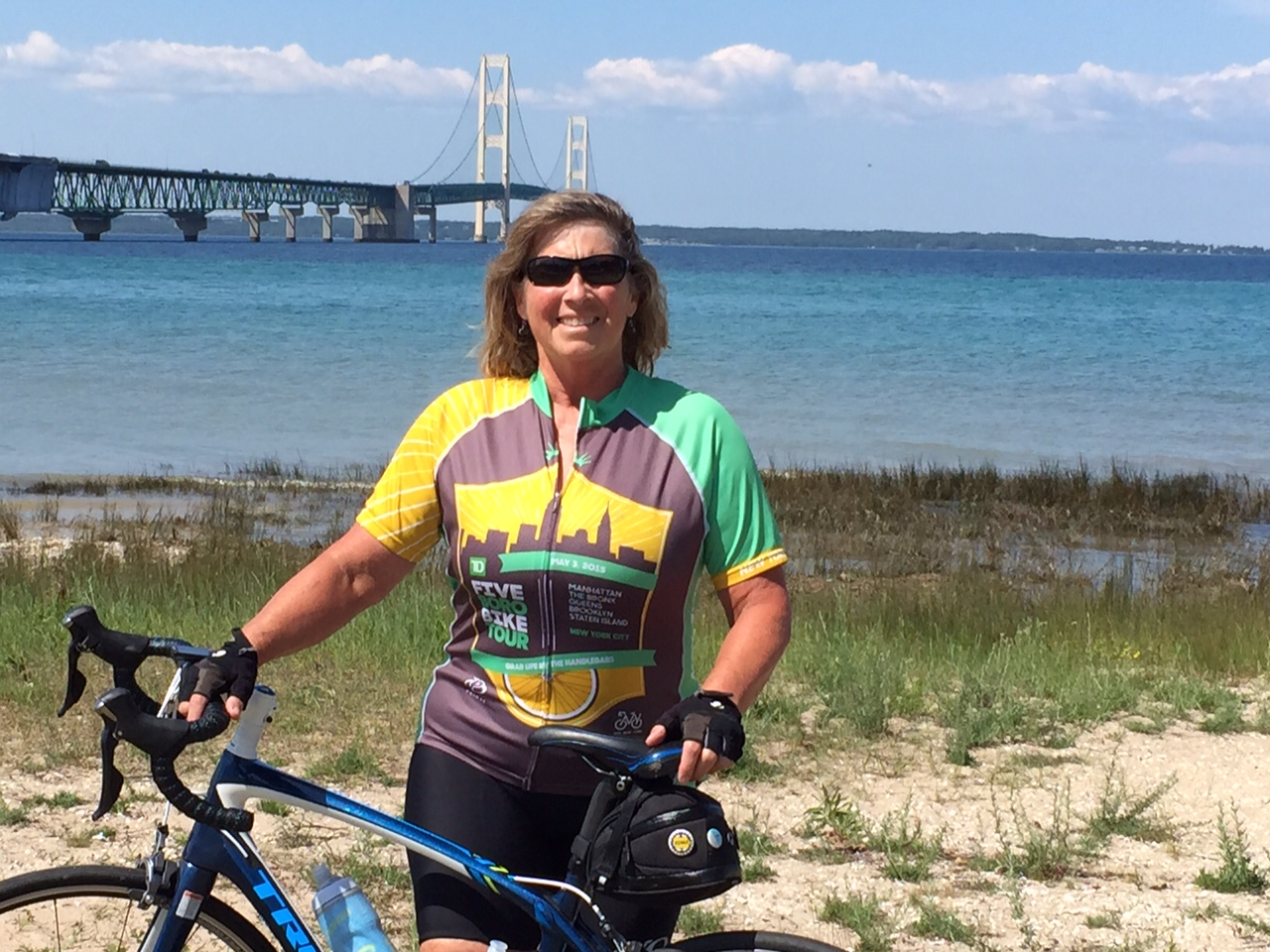 Iowa cyclist pedals her way toward $10,000 to support INHF