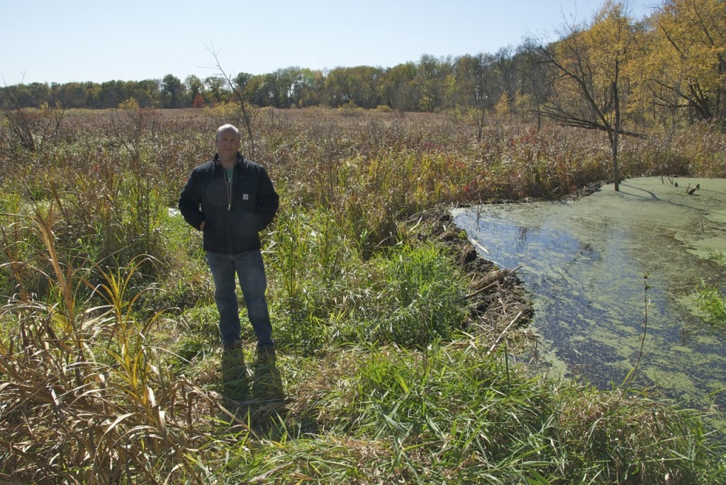Matt Fisher, Eastern Iowa Project Director for The Nature Conservancy, in a Lower Cedar wetland at the conservation group's Maytag Tract in Muscatine County.