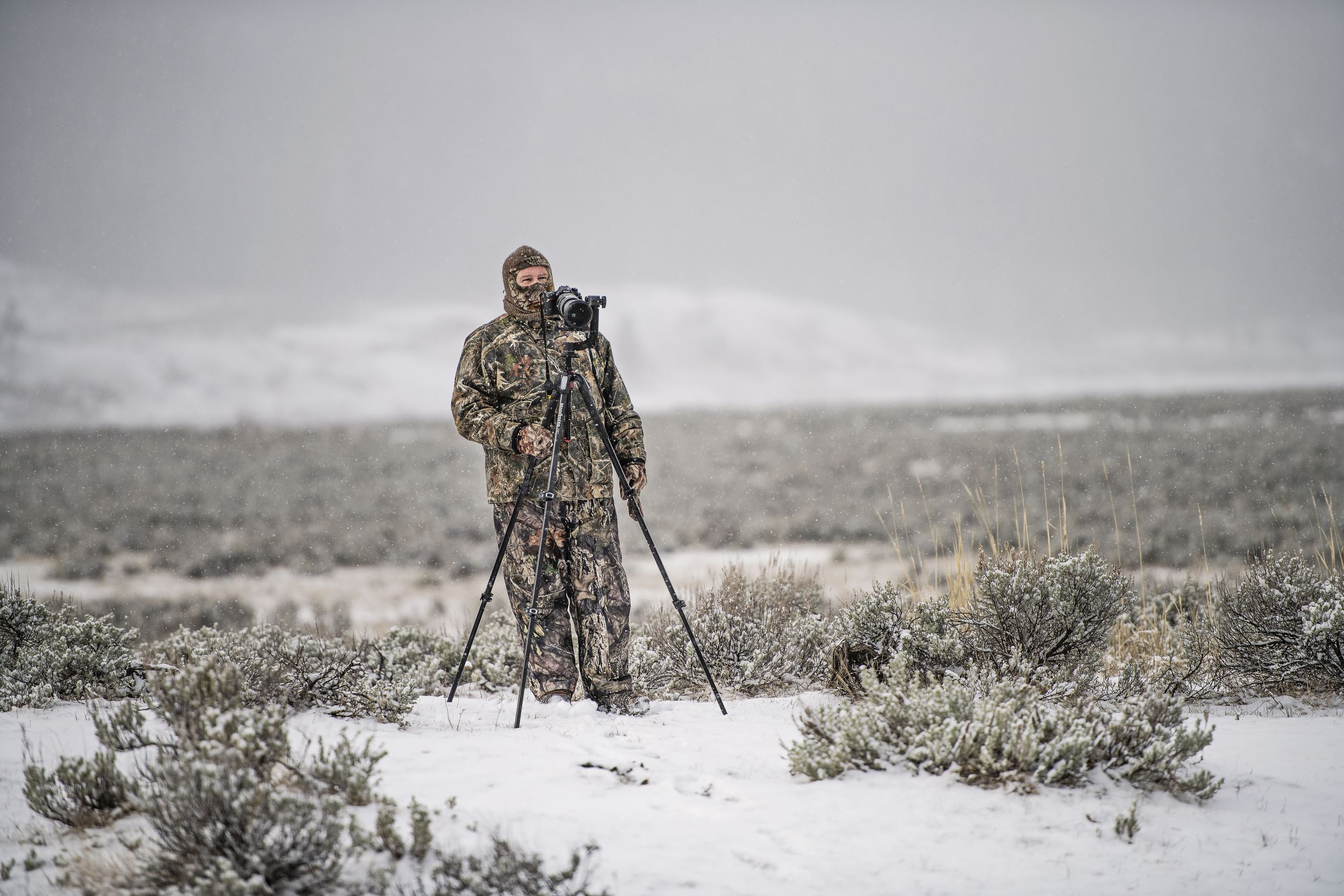 photographer in camo in snow