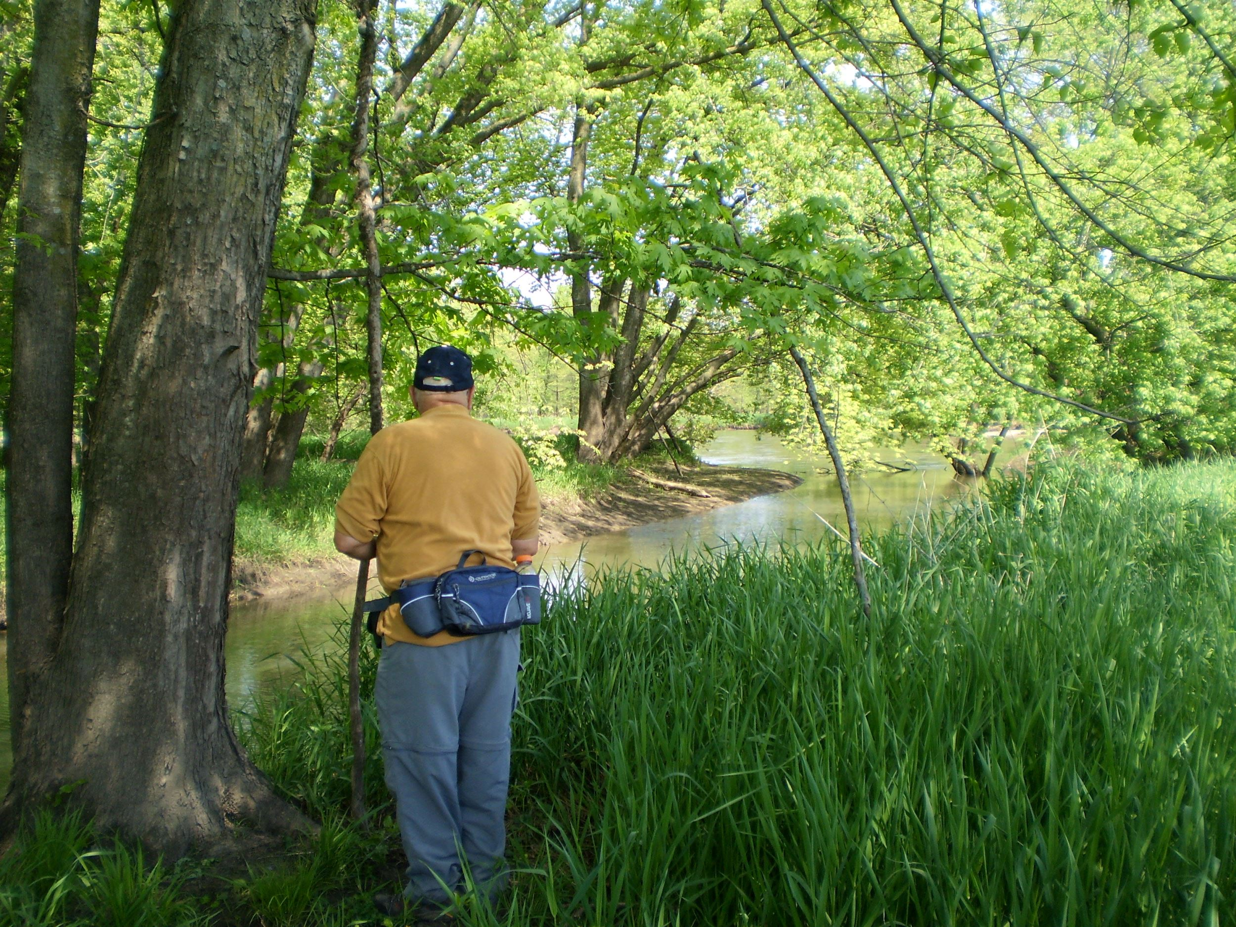 Man looking upon Wapsipinicon River