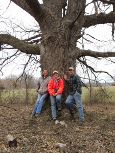 INHF land stewardship staff Tylar Samuels, Erin Van Waus and Ryan Schmidt in front of a large Bur oak on the Gardner property in Boone County.